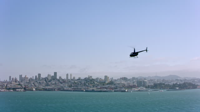 AERIAL Helicopter flying in the San Francisco Bay overlooking the city on a sunny day.