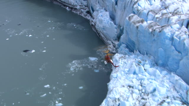 Helicopter flying over glacier, Alaska video