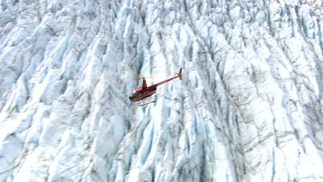 Helicopter flying over glacier in Alaska video
