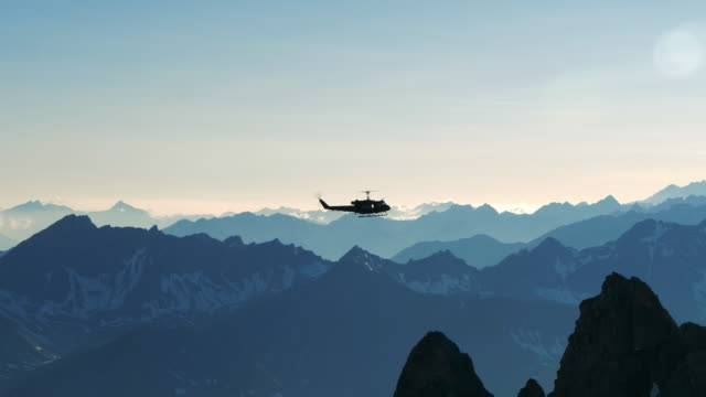 Helicopter flying over the mountains