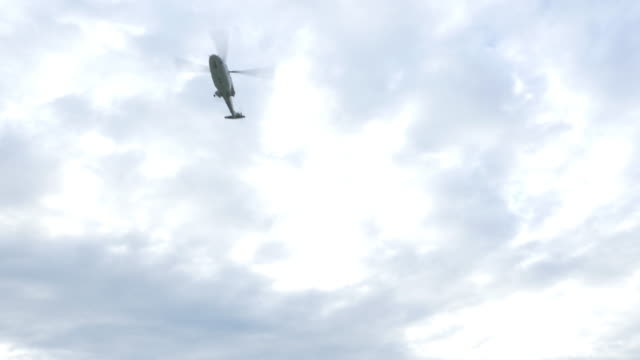 Helicopter flying over the sky. Helicopter flying over the sky. homecoming stock videos & royalty-free footage