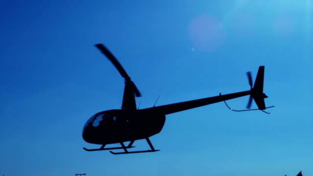 Helicopter in Flight Helicopter silhouette in the sky hovering stock videos & royalty-free footage