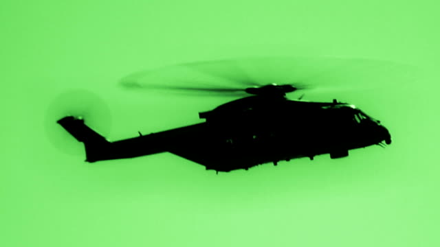 Helicopter In Night Vision Merlin military helicopter filmed in night vision hovering stock videos & royalty-free footage