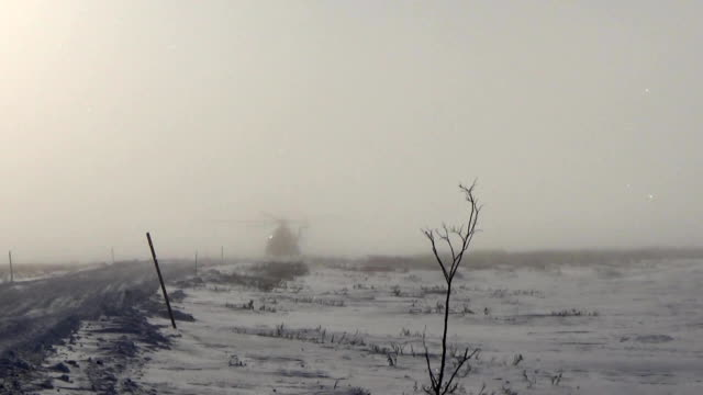 Helicopter in winter fog Helicopter in winter fog medevac stock videos & royalty-free footage