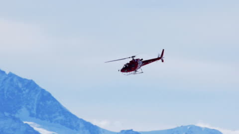 Helicopter in winter mountains Helicopter in winter mountains helicopter stock videos & royalty-free footage