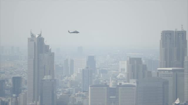 ヘリコプター patrolling 、東京 - ヘリコプター点の映像素材/bロール