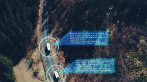 vídeos de stock e filmes b-roll de helicopter shot of self driving trucks driving on a forest highway with technology assistant tracking information, showing details. visual effects clip - transporte assunto