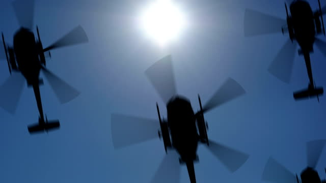 Helicopter silhouette in the sky. Seamless loop, HD video