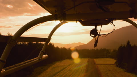 AERIAL Helicopter taking off at sunrise Aerial shot of the landing skids of the helicopter as it takes off at sunrise. Shot in USA. helicopter stock videos & royalty-free footage