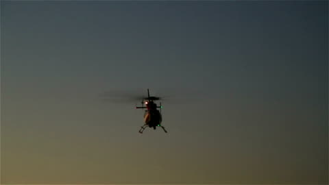 Helicopter Helicopter landing at dusk. helicopter stock videos & royalty-free footage