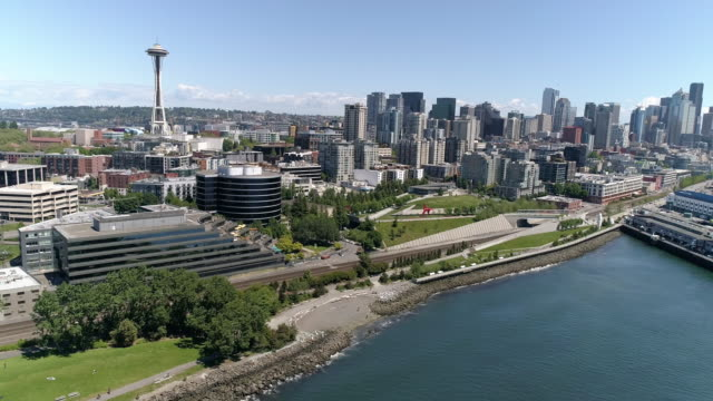 Helicopter View of Downtown Seattle Buildings in Skyline and Waterfront Piers on Sunny Summer Day video