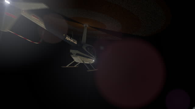 Helicopters fly past the camera in the night sky.