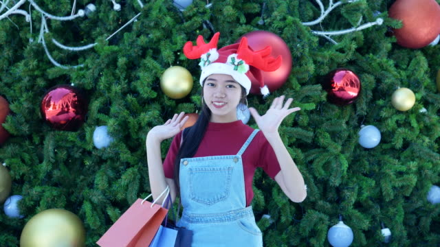 hello and goodbye sign by young woman in Christmas time video