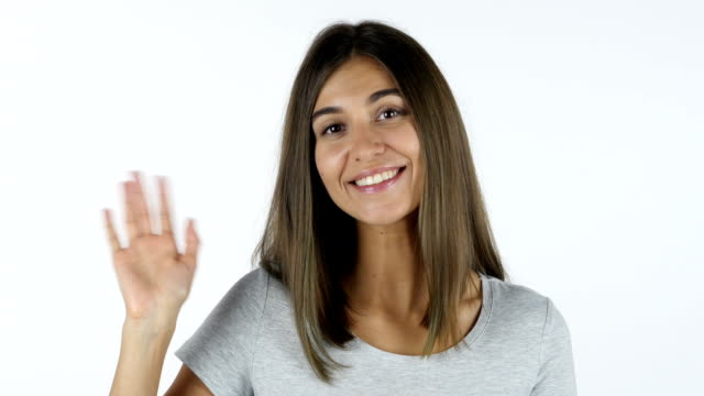 Hello, Beautiful Girl Waving Hand, White Background in Studio video