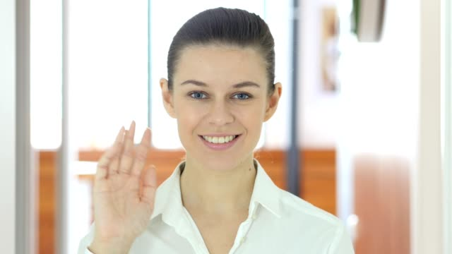 Hello by Woman, Indoor Waving Hand video