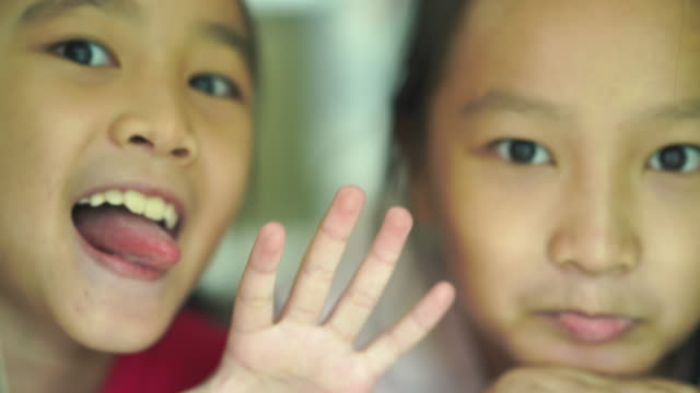 hello, goodbye by two Asian little girls