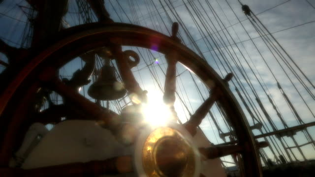helm of tall ship - stylized old movie video