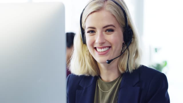 Help is a phonecall away 4k video footage of an attractive young female customer service agent working in the office call centre videos stock videos & royalty-free footage