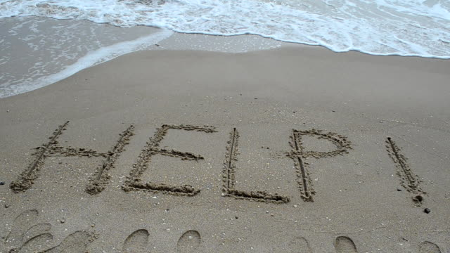 Help Sign on the sand of tropical sea beach video