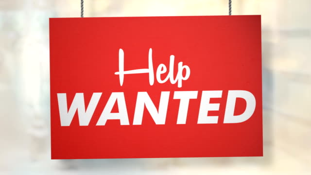 Help wanted sign hanging from ropes. Luma matte included so you can put your own background. video