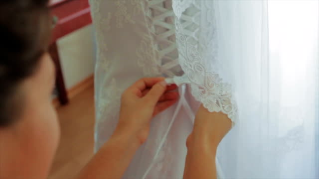 Helping Bride With a Dress Lace Bride in Wedding Dress. Helping Bride With a Dress. White Dress With Lace tulle netting stock videos & royalty-free footage