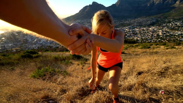 Helping hand at mountain top video