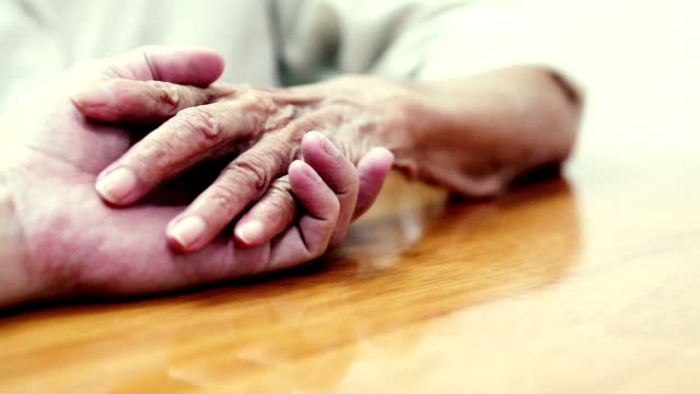 Helping hand Elderly hand and caregiver sociology stock videos & royalty-free footage
