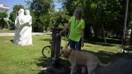 istock Helping her dog get a drink 1320254095