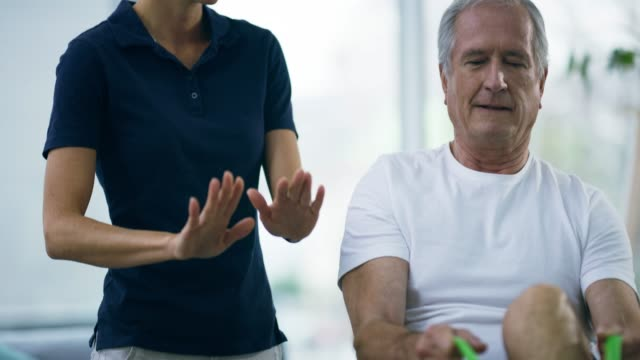 helping him get it just right - chiropractor stock videos & royalty-free footage