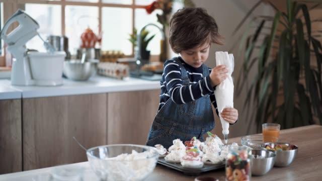Helping His Mom to Make Birthday Muffins