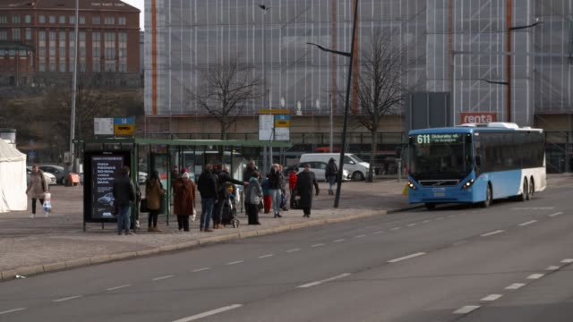 Helsinki city bus arriving to bus stop People waiting for arriving bus bus stop stock videos & royalty-free footage