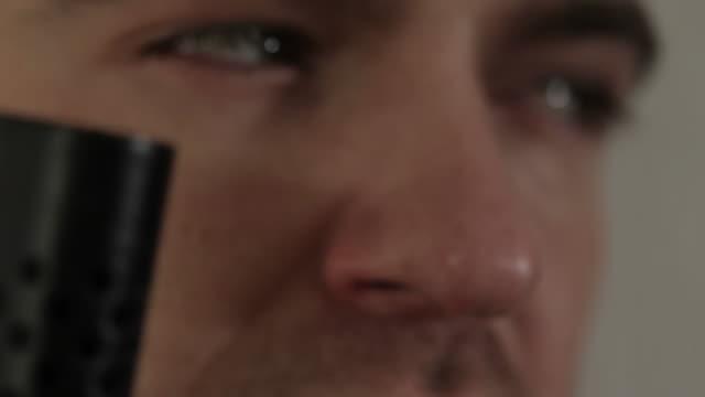 Henchman with silenced handgun video