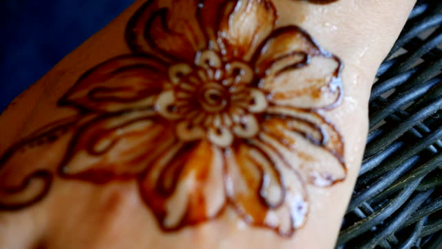 Henna pattern on the female hand. video