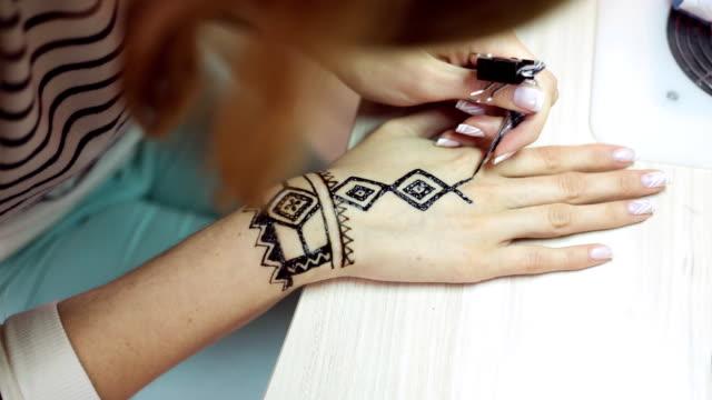 Henna tattoo on women hands video