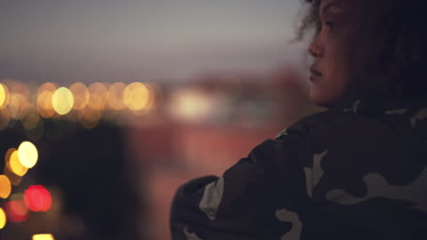 Her deep thoughts could drown the whole city in innovation 4k video footage of a beautiful young woman standing on a rooftop and looking over the city at night carefree stock videos & royalty-free footage