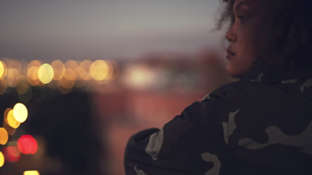 Her deep thoughts could drown the whole city in innovation 4k video footage of a beautiful young woman standing on a rooftop and looking over the city at night rooftop stock videos & royalty-free footage