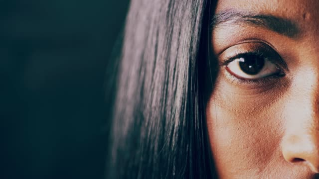 Her eyes tell her story Closeup 4K video footage of a woman opening her eyes against a dark background eye stock videos & royalty-free footage
