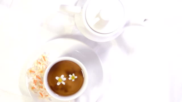 Herbal tea and Teapot on rotating table video