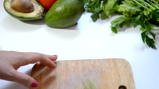 Herbs and vegetables with a blank chopping board. video