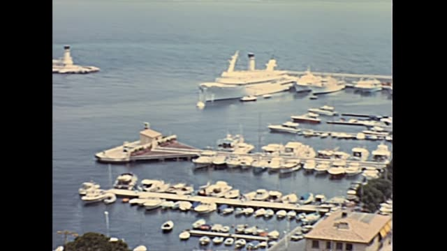 Hercule port Monte Carlo Aerial view on port Hercule in Monte Carlo and roads of the Grand Prix of Monaco, from Prince's Palace of Monaco overlook. Historic restored footage on 1960s in France. monte carlo stock videos & royalty-free footage