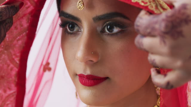 Here comes the bride 4k video footage of a young woman getting covered with a veil on her wedding day indian culture stock videos & royalty-free footage