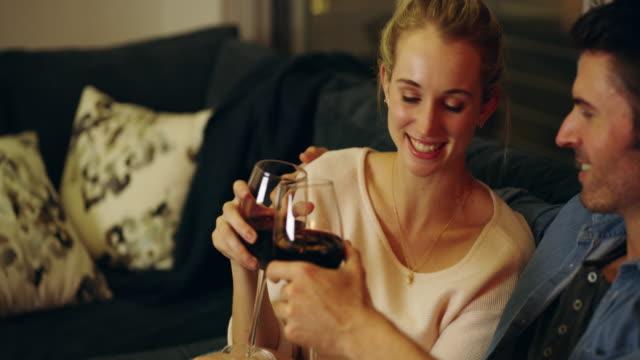 vídeos de stock e filmes b-roll de here's to many more romantic moments - vinho