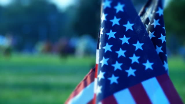 Hero's Grave Jib shot of American flag on grave. memorial day stock videos & royalty-free footage