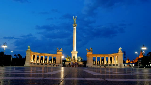 Hero's Square in Budapest at night Hero's Square in Budapest, Hungary in late summer evening with tourists passing by near the famous landmark in Hungarian capital hungary stock videos & royalty-free footage