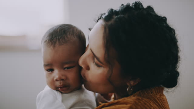 He's a part of me 4k video footage of a young woman bonding with her baby at home newborn stock videos & royalty-free footage