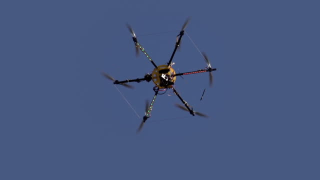 Hexacopter Drops Slowly Radio controlled hexacopter flying machine. Motion at a rate of 240 fps telephone receiver stock videos & royalty-free footage