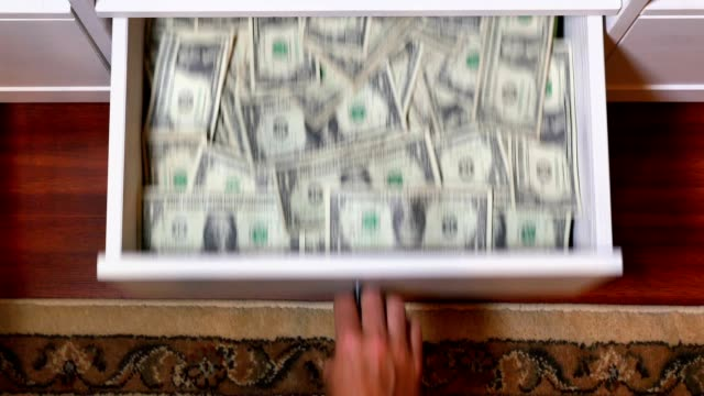 Hidden Drawer Full of US Currency