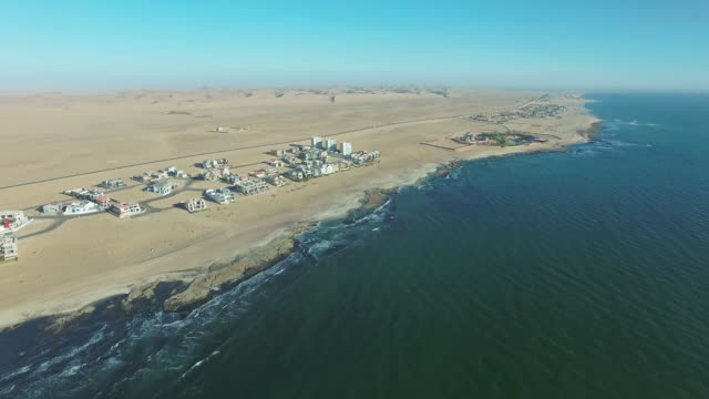 High above Swakopmund 4k aerial drone footage of the town of Swakopmund in Namibia swakopmund stock videos & royalty-free footage