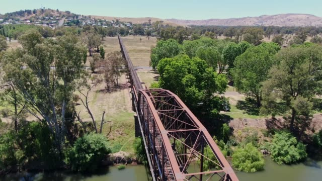High angle aerial drone footage of the historic Gundagai Railway Viaduct and truss bridge, part of the disused Tumut Railway line near Murrumbidgee River in Gundagai, New South Wales, Australia.