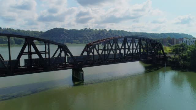 High Angle Aerial Establishing Shot of Train On a Railroad Bridge Over Ohio River video